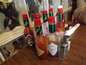 Selection of hot sauce at Katie's on the corner of N. Telemachus St. and Iberville St., New Orleans