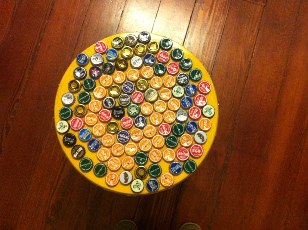 A stool in our lobby covered with bottle caps. It's surprising comfortable, like a massage.