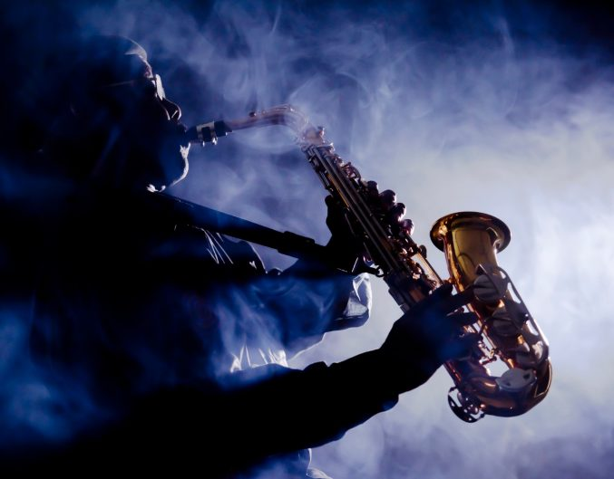 African jazz musician playing the saxophone | Live Music Venues in New Orleans